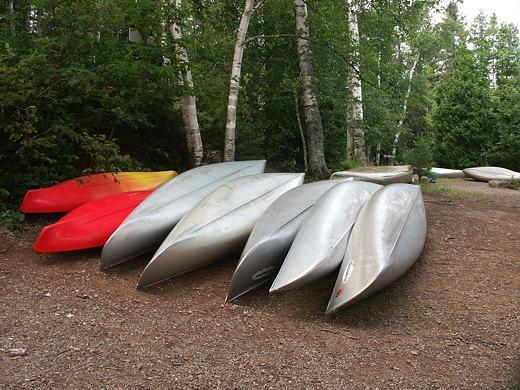 Canoes wait along Sawbill Lake
